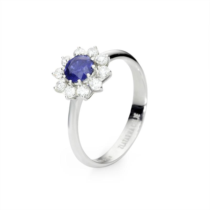 Blue sapphire fi 5 mm - 1 x; diamond 0,03 ct - 10 x